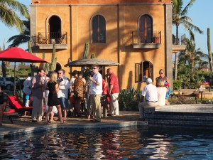 guests gathered around the pool for cocktails and appetizers